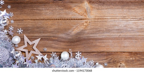 silver christmas balls on wooden board, christmas background with copy space