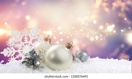 Silver christmas balls over snow isolated on white