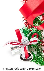 Silver Christmas bells decorating with red ribbon with copy space.