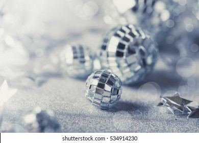 Silver Christmas composition with silver baubles sparkling