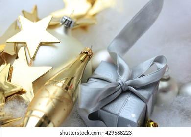 Silver christmas gift and golden decorations