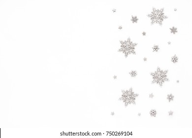 Silver christmas snowflake on white background, flat lay, top view, christmas pattern