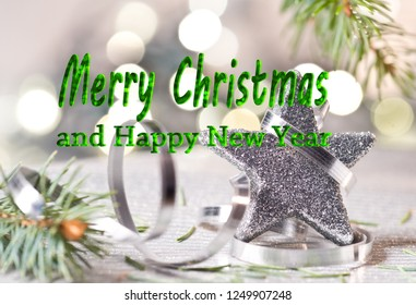 Silver Christmas star with text Merry Christmas and happy new year.