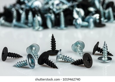 silver chrom and black anodized screws on white background