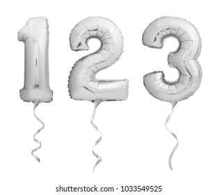 Silver chrome numbers 1, 2, 3 made of inflatable balloons with ribbons isolated on white background