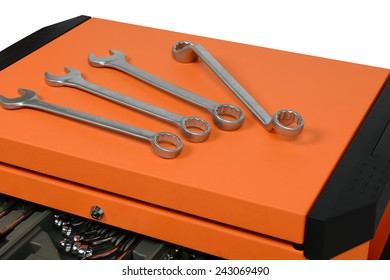 silver chrome-plated wrench spanner, close-up on tool cabinets