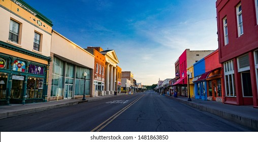 Silver City, New Mexico USA - July 30, 2019: Bullard Street in downtown Silver City, looking north early on a summer morning. A historic southwestern mining town with shops, stores and restaurants.