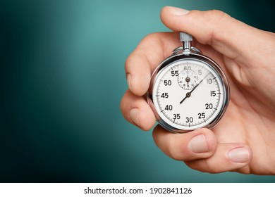 Silver classic stopwatch in human hand