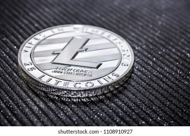 Silver coin cryptocurrency litecoin on black background. LTC