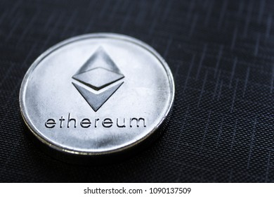 Silver coin Ethereum on black texture background. ETH cryprtocurrency.