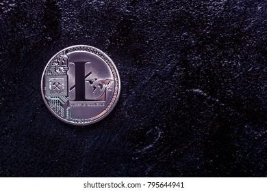 silver coin Litecoin on a dark background