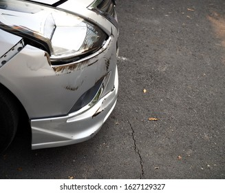 Silver color car  Accident with another car, damage to the bumper and front of the body  Parked waiting for the insurance company to tow the car for repair at the garage.