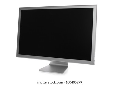 Silver computer monitor with black screen on white background