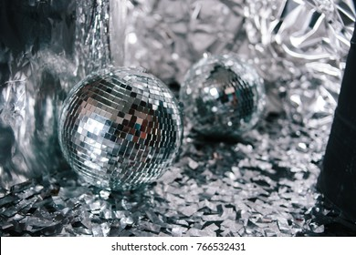 silver confetti on the floor. party decorations. disco balls close-up