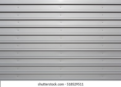 Silver corrugated metal with bolts, horizontal orientation