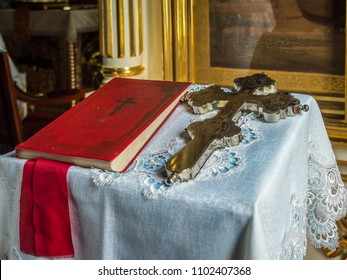 A silver cross and a bible in the orthodox church in Koterka.