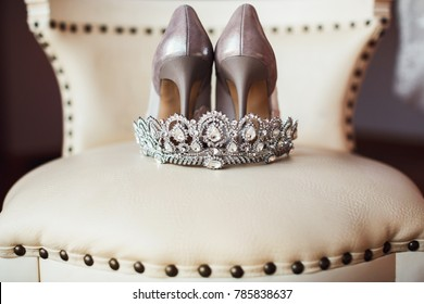 silver crown and bridal shoes