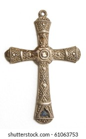 Silver crucifix over white background