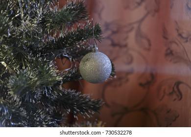 Silver crystal ball on a Christmas tree.
