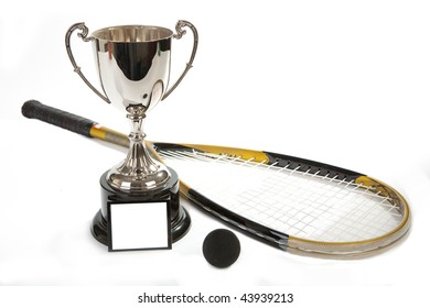 A silver cup  with squash ball and racket,  white space on cup for copy