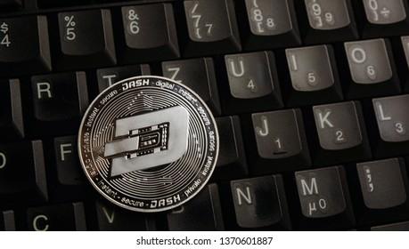 Silver dash coin on laptop keyboard