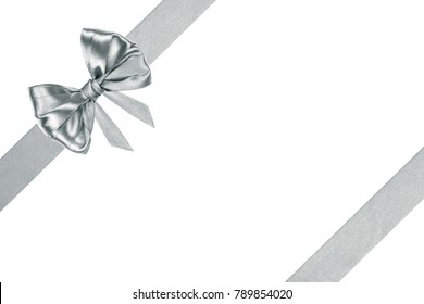 silver decorative gift silk ribbon bow with diagonal ribbons on white background