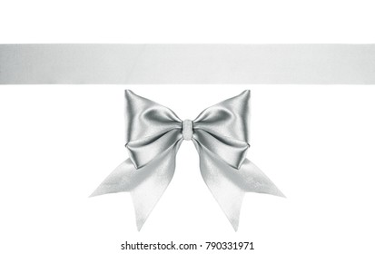 silver decorative satin ribbon bow with horizontal ribbon isolated on white. holiday background