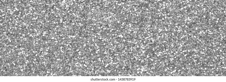 Silver decorative sequins. Background image with shiny bokeh lights from small elements