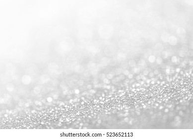 Silver defocused glitter background with copy space.
