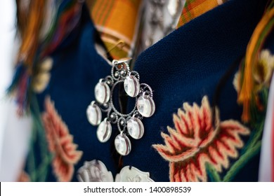 "Silver details on a Norwegian ""bunad"", national costume."
