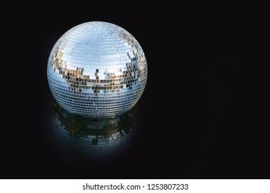 Silver disco mirror ball close up shot