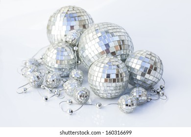 Silver disco mirror balls isolated on white background, christmas decoration