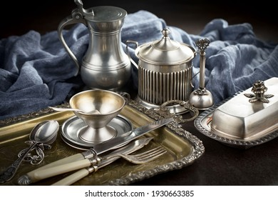 Silver dishes on old background