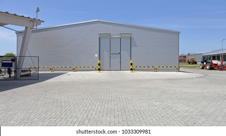Silver Distribution Warehouse Building Exterior With Cargo Door