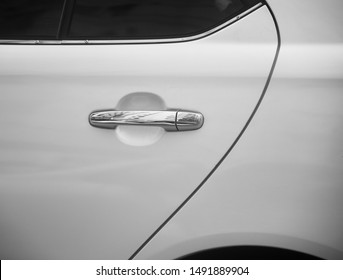 Silver door knobs of a white car unique photo
