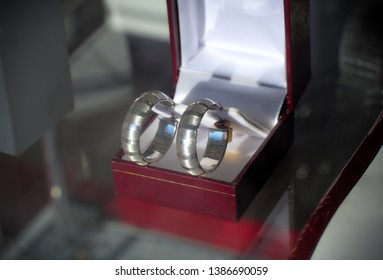 silver earrings in box jewelry store showcase