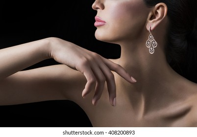 Silver earrings with diamonds on human female model