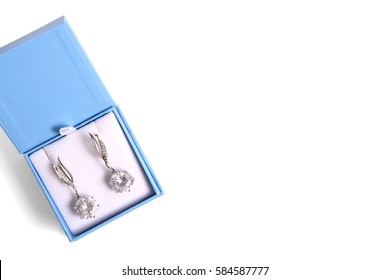 Silver earrings in the gift box. on a white background. gift concept.