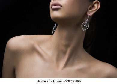 Silver earrings with green pearl and diamonds on human female model