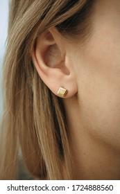 silver earrings on the ear
