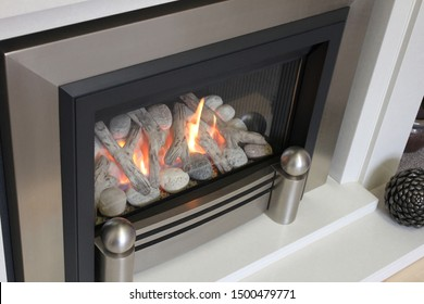 Silver electric fireplace with white hearth