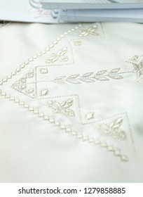 silver embroidery on white kitchen towel
