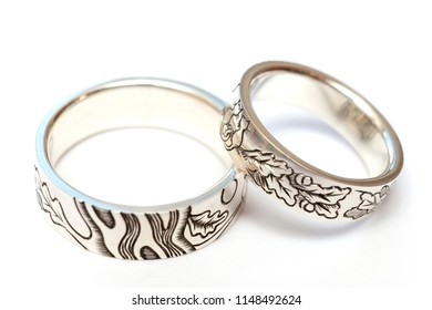 Silver engagement rings with engraving according to the author's sketch. A photo on a white background, isolate.