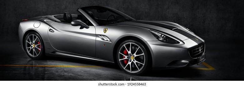 Silver Ferrari California. Cabriolet with V8  engine, 4,3L, 460 hp. Model 2008-2017. Katowice, Poland - 26.06.2013