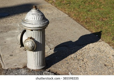 Silver fire hydrant with shadow