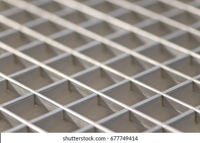 Silver floor grid texture; Stainless metal floor grating in close up; Metal product; Iron and steel industry