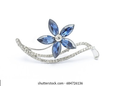 Silver flower brooch isolated on white