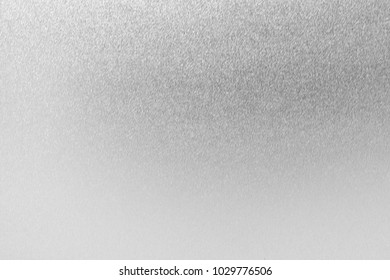 Silver foil metal texture background wrapping glitter and sparkle white gray paper for wallpaper decoration element blur light