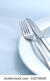 Silver Fork and knife on a dish