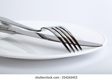 Silver fork and knife on the plate